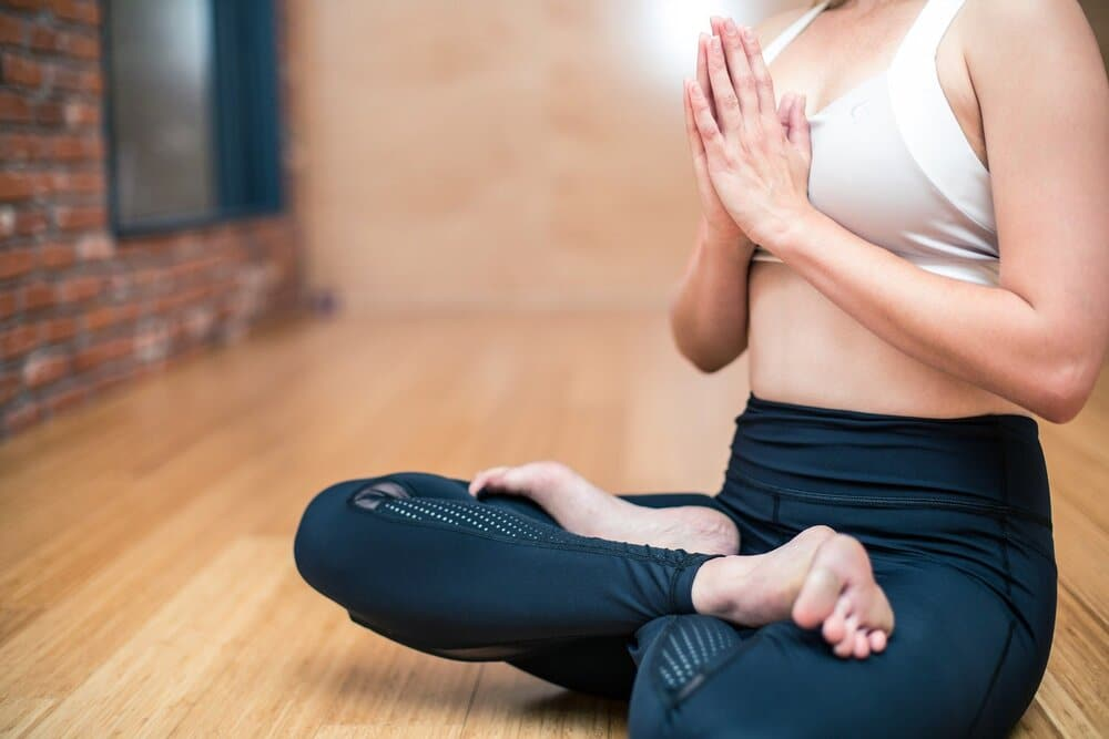 woman sits in yoga pose