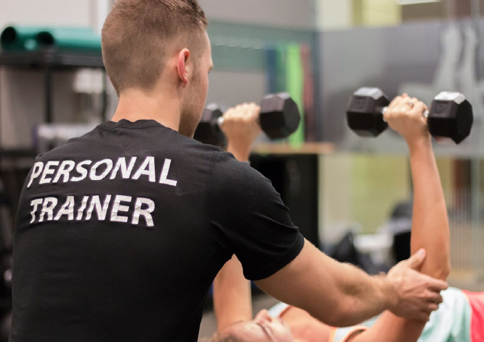 personal trainer works with client