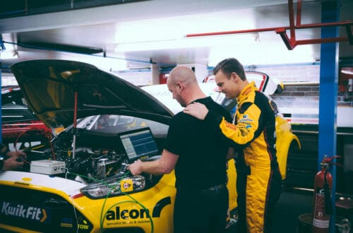 tom chilton over looking engine of his car