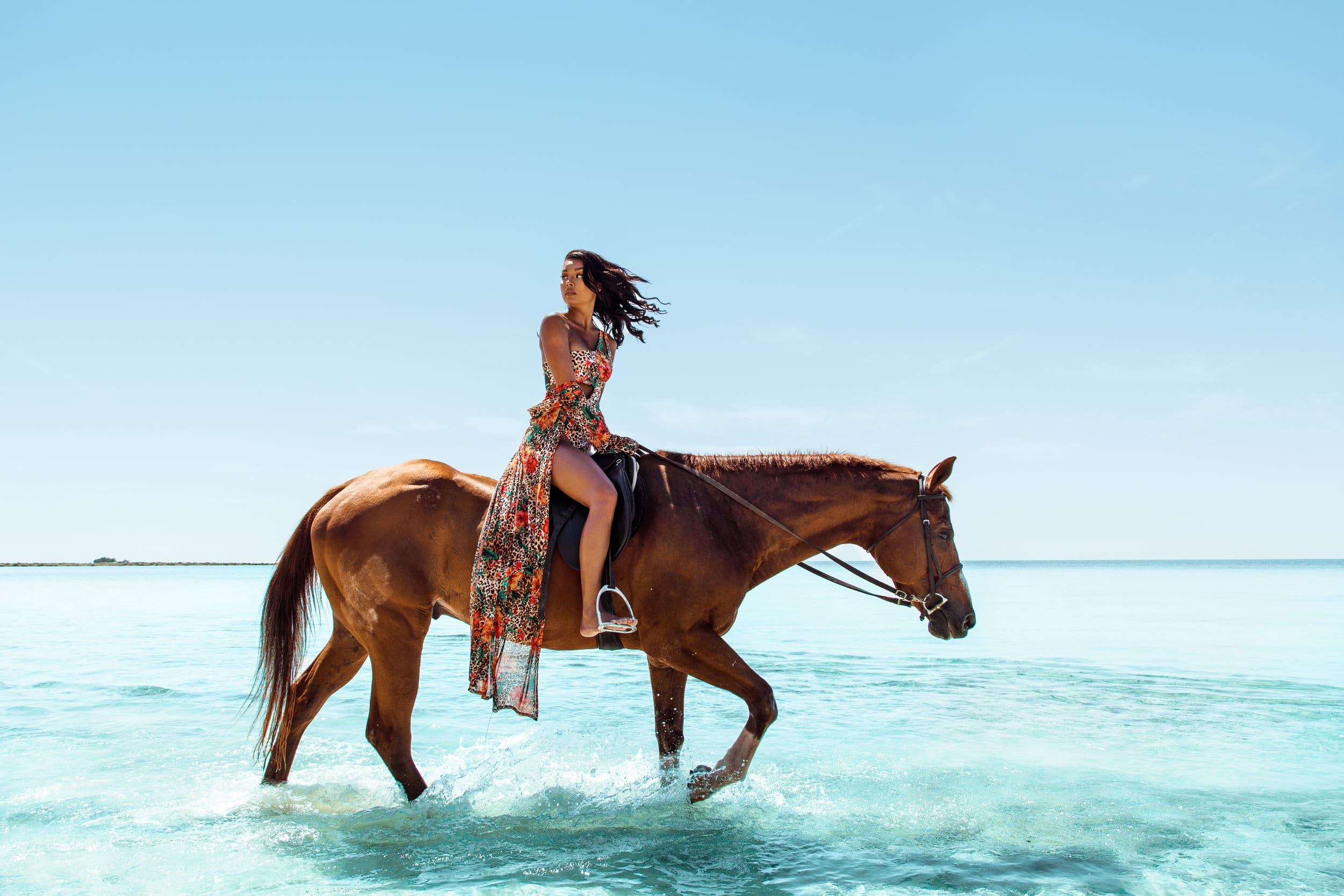 woman riding on a horse in the sea