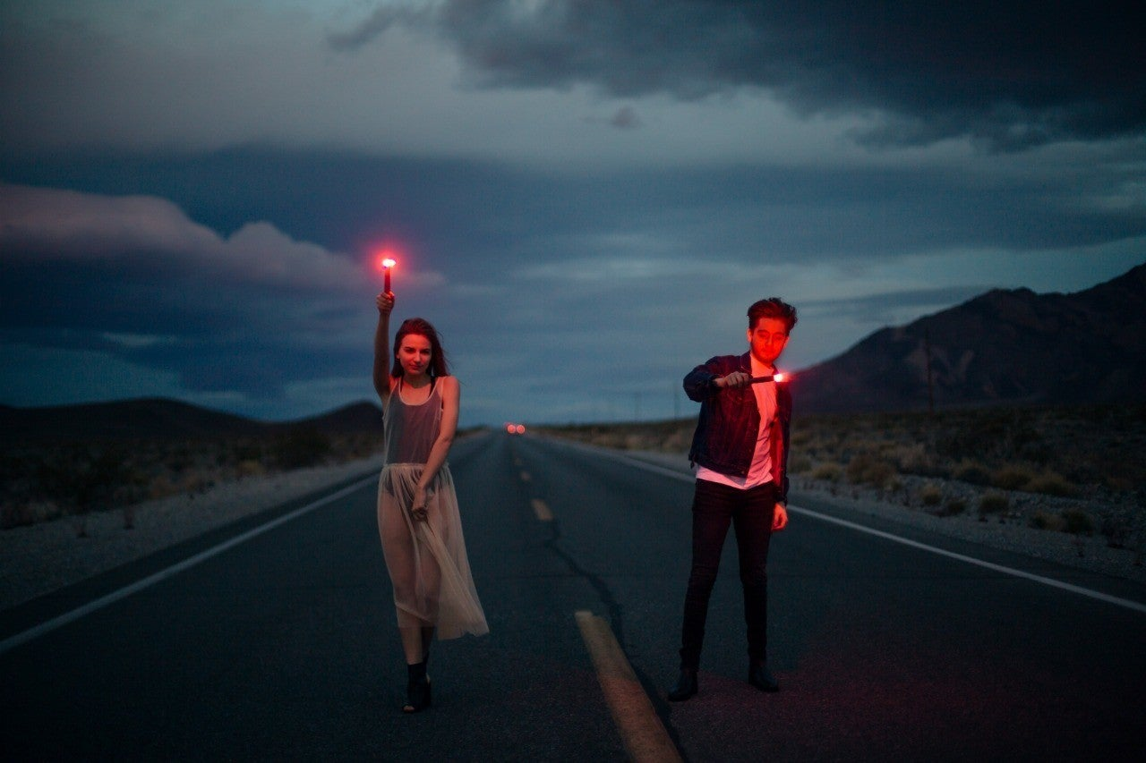 couple in road with firelights