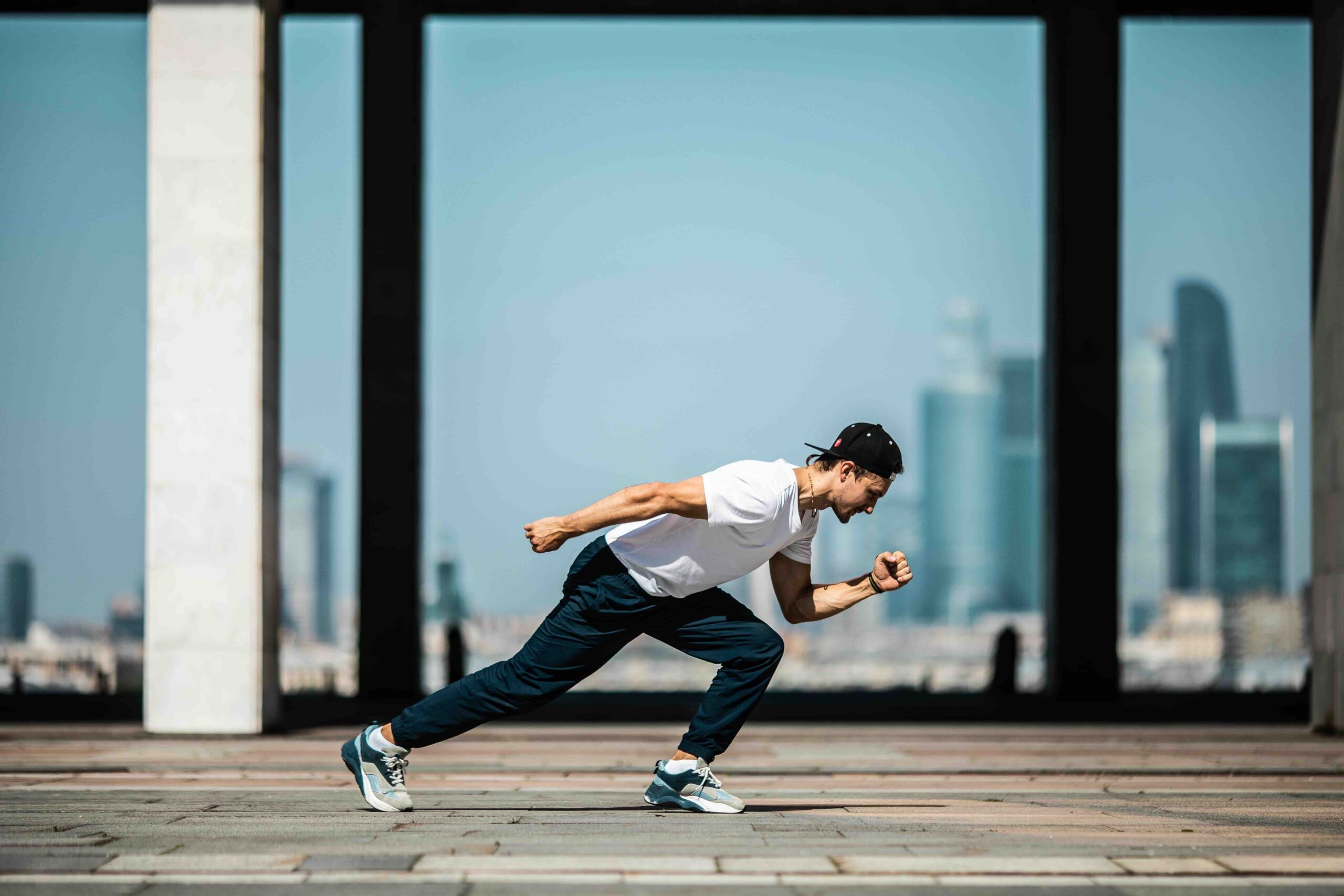 man in white t shirt and black pants in a running position 4048182 scaled