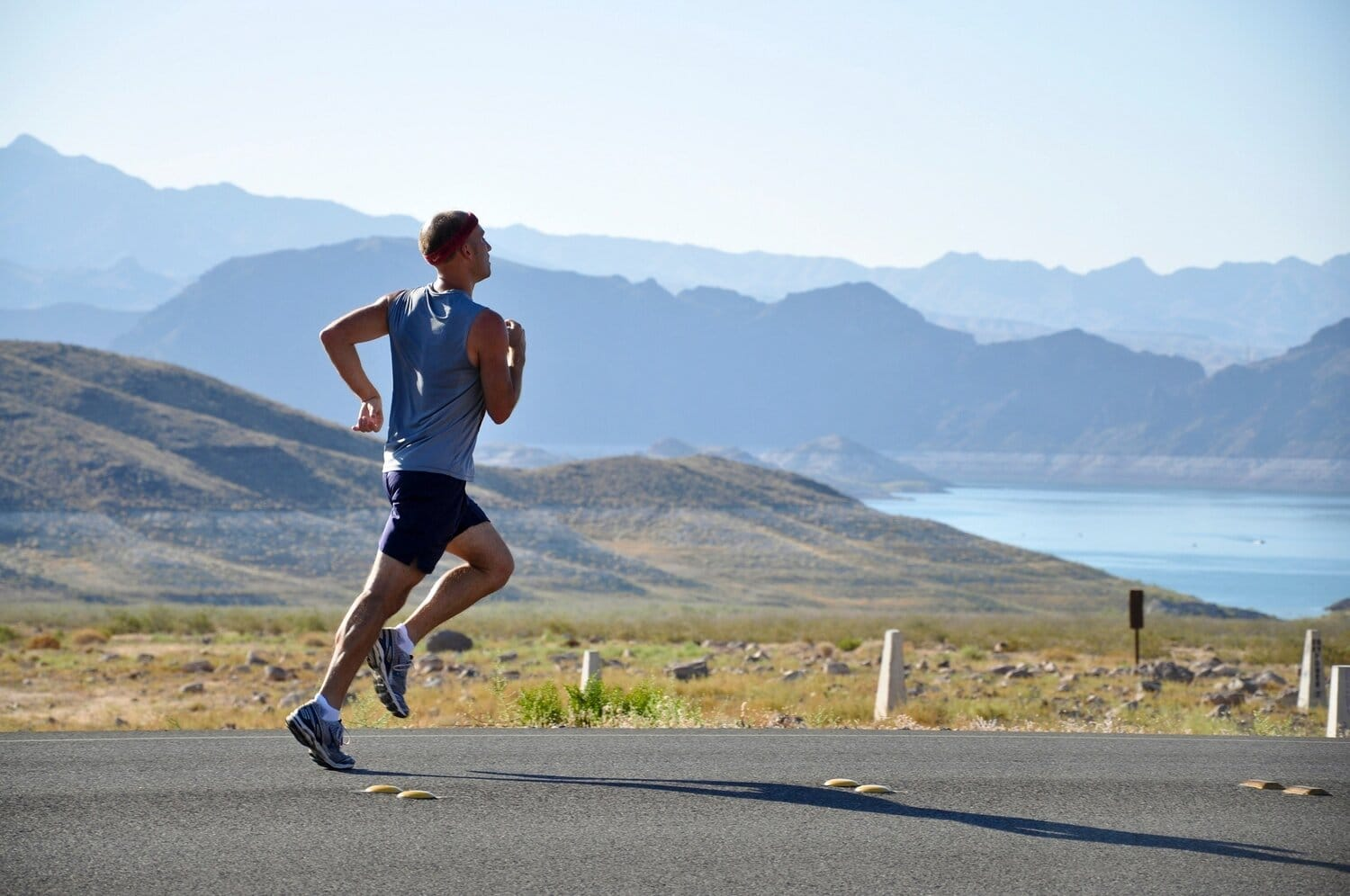 runner with mountains in background