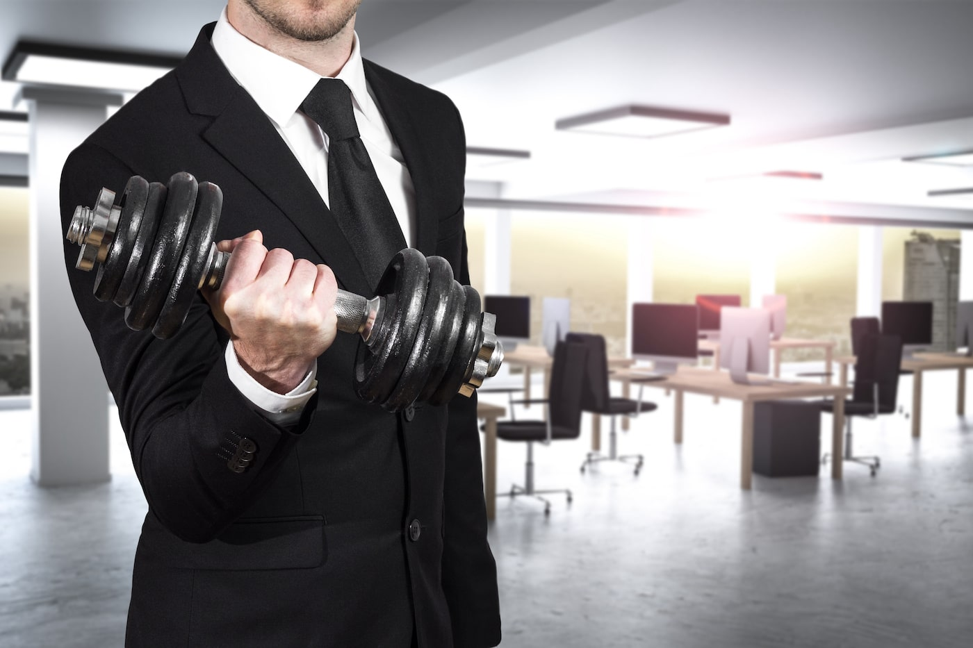 businessman in modern office wheightlifting power