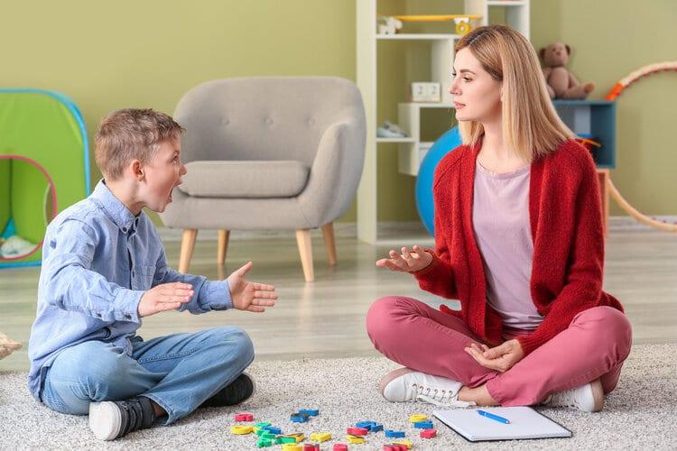 Femalepsychologistworkingwithboysufferingfromautisticdisorder