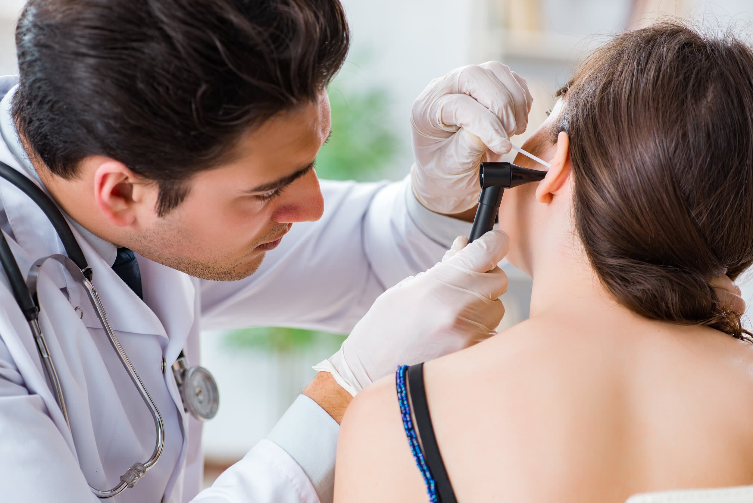 doctor looking at patients ear