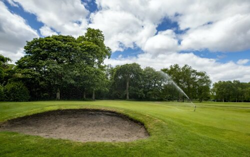 golf bunker being watered