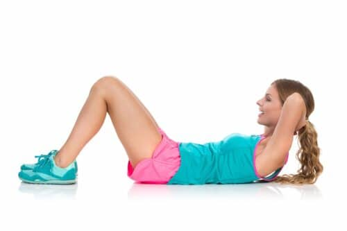 woman does crunches