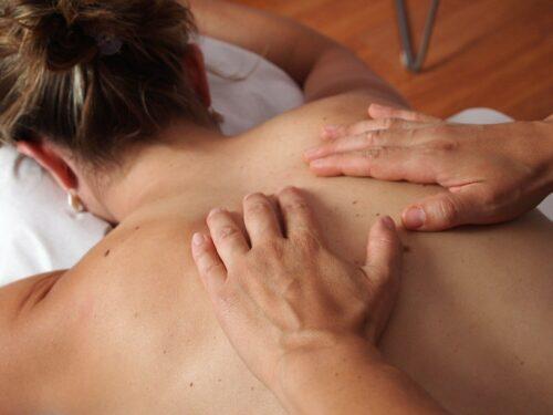 woman having back massaged