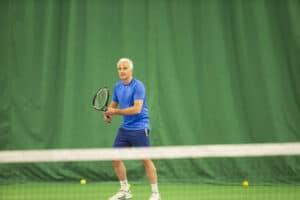 older active man play tennis