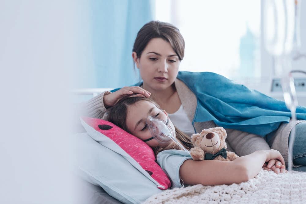 mothercomfortingchildwithcysticfibrosis