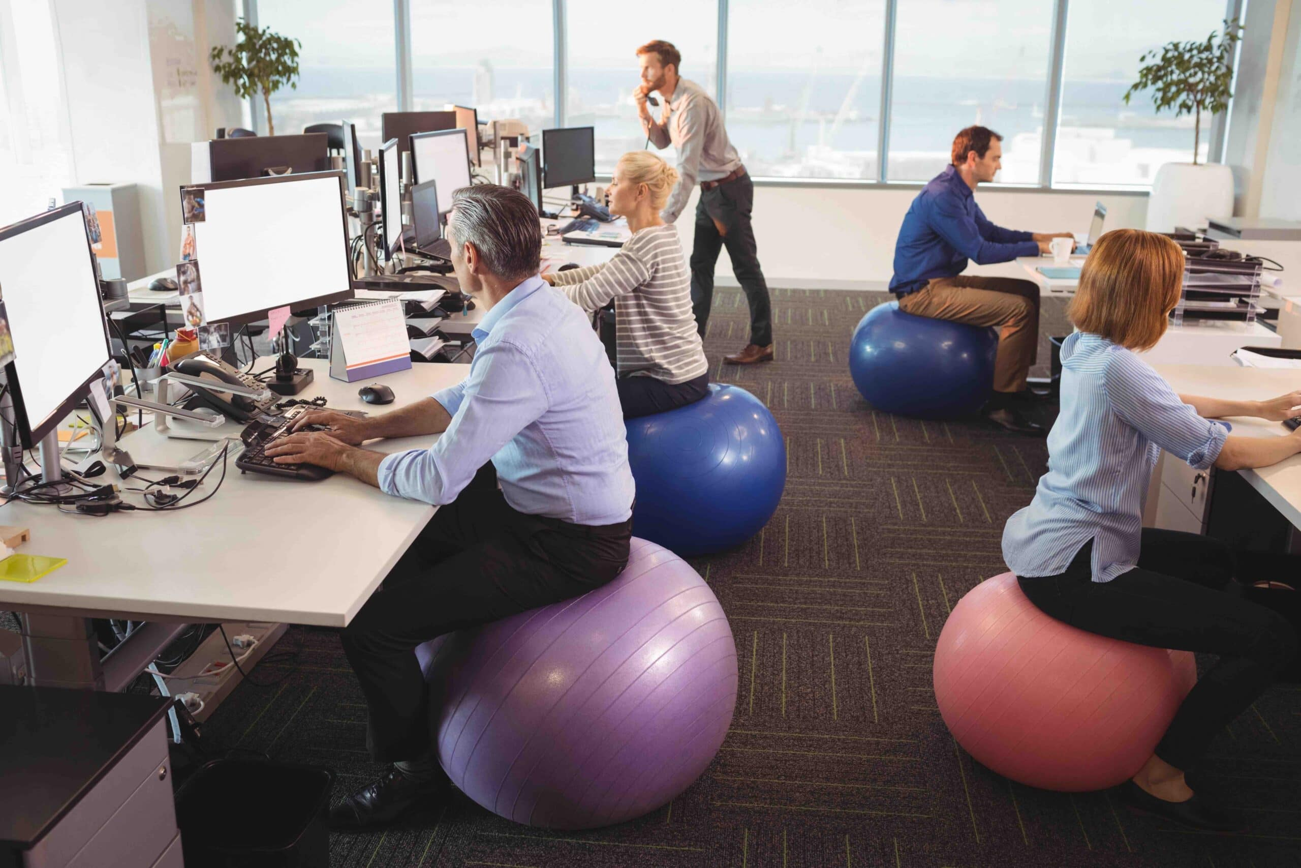 office workers sitting on gym ball