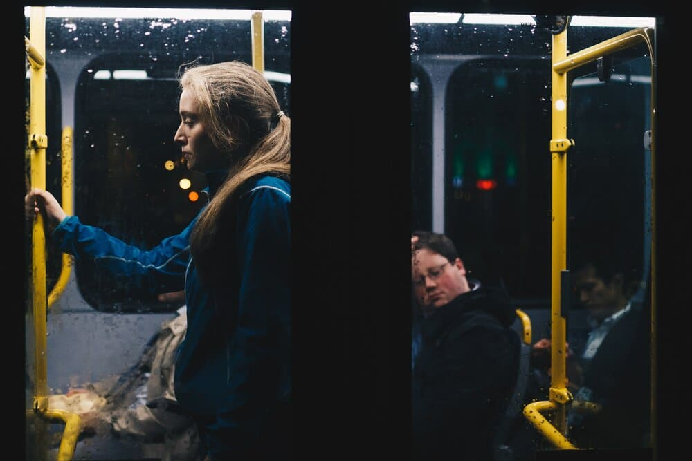 photo of a woman standing inside bus 808700