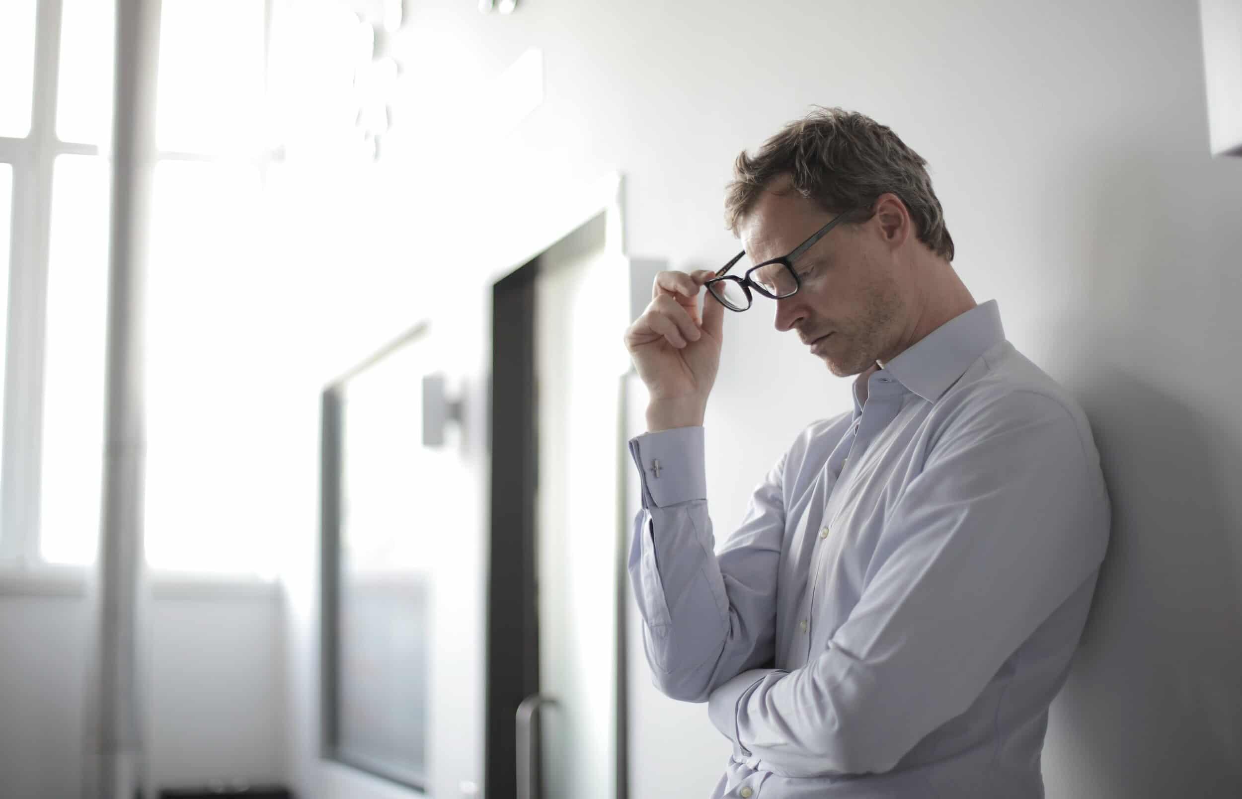 photo of man holding black eyeglasses 3760137