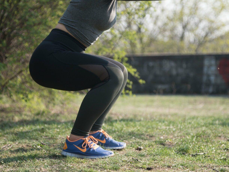 woman holding squat