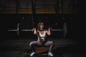 woman lifting barbell 1552249