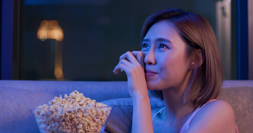 womancryingatfilmwithpopcorn
