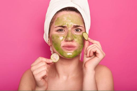 womanwearinggreenfacemask