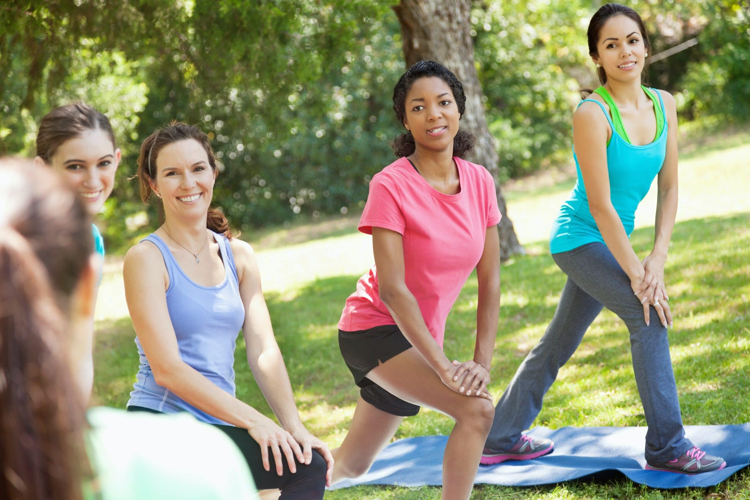 women working out outdoors