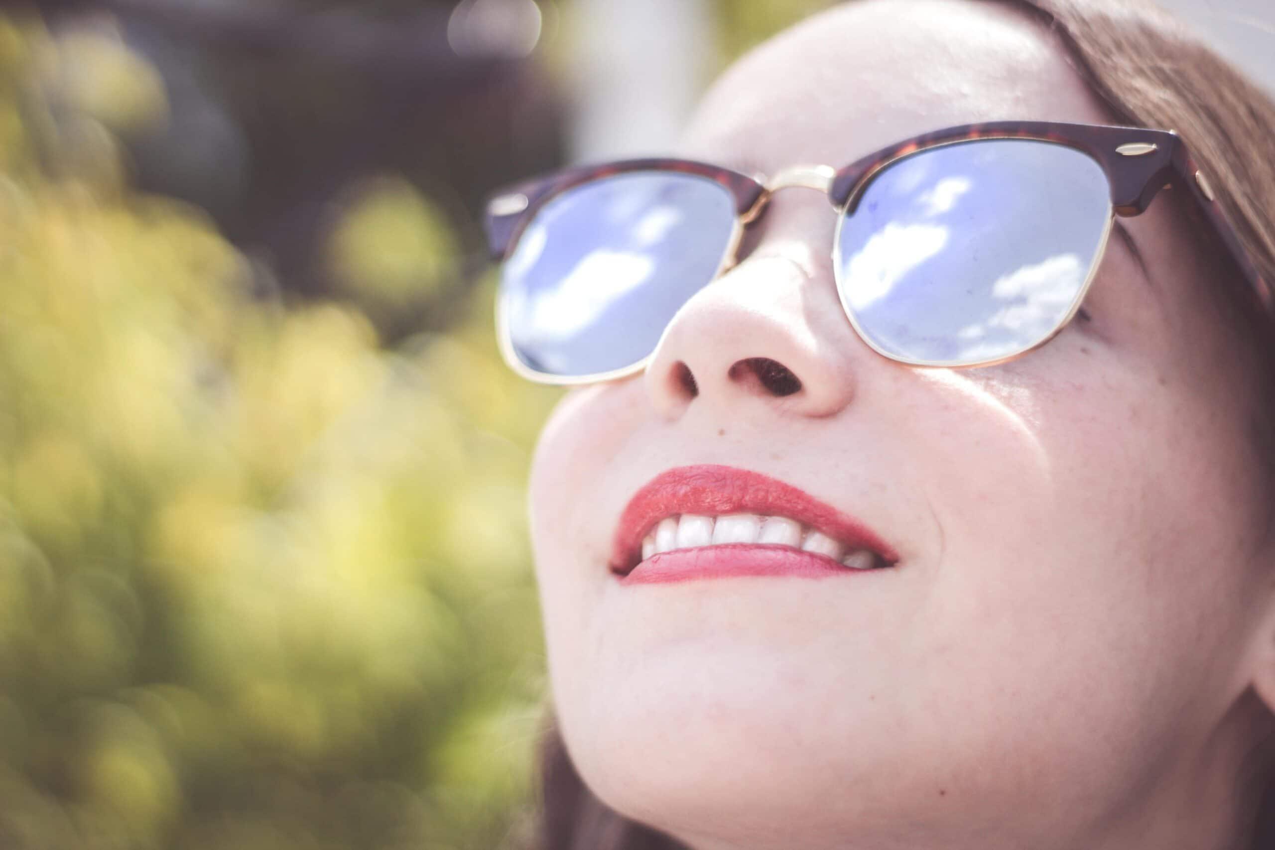 woman_wearing_blue_framed_sunglasses