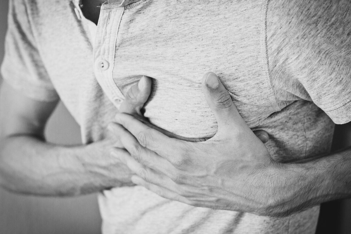 man holds chest
