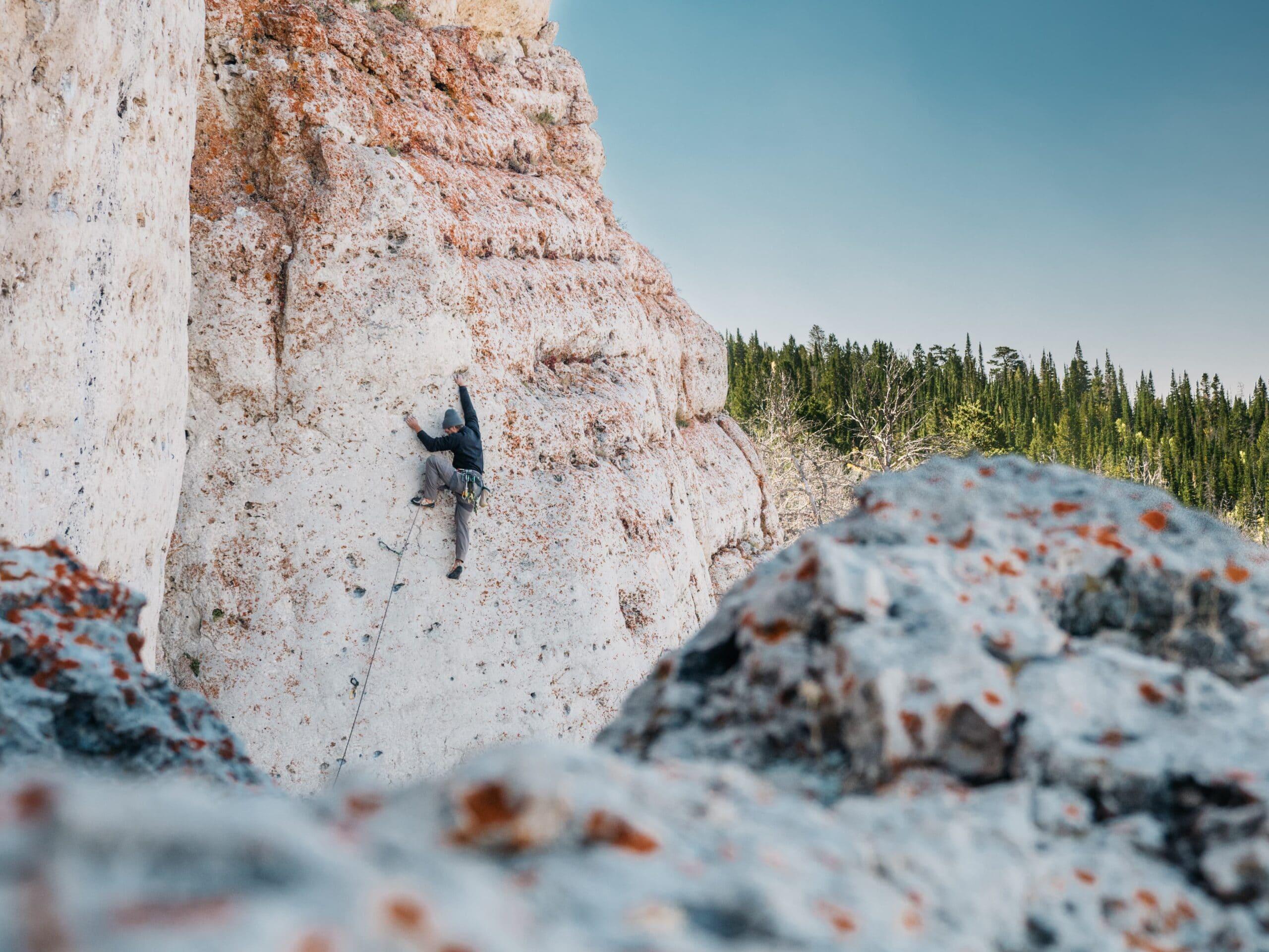 man rock climbing scaled