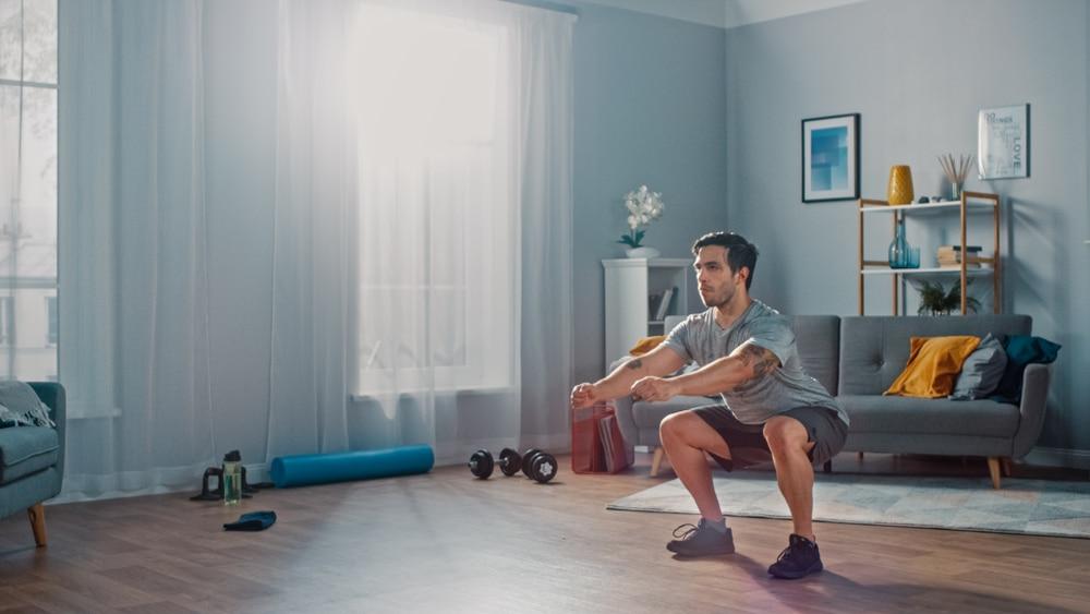man squats photo credits Gorodenkoff