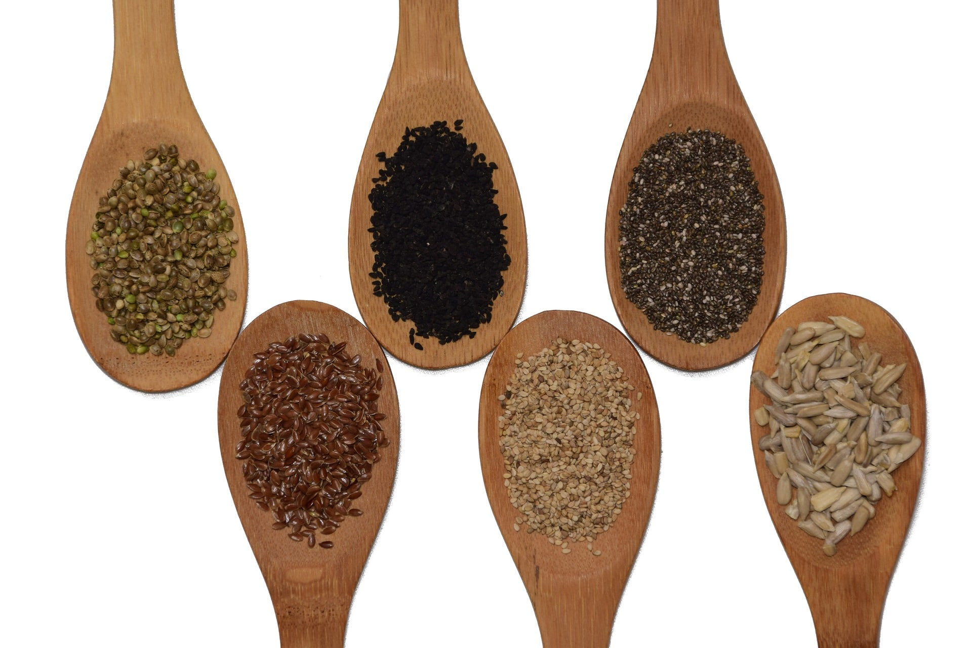 mixture of seeds on spoons