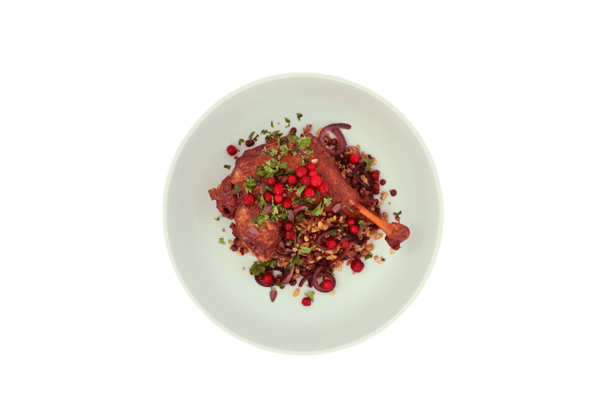 Massaman Duck Leg with freekah puy lentils roasted red onions and lingonberries. 1