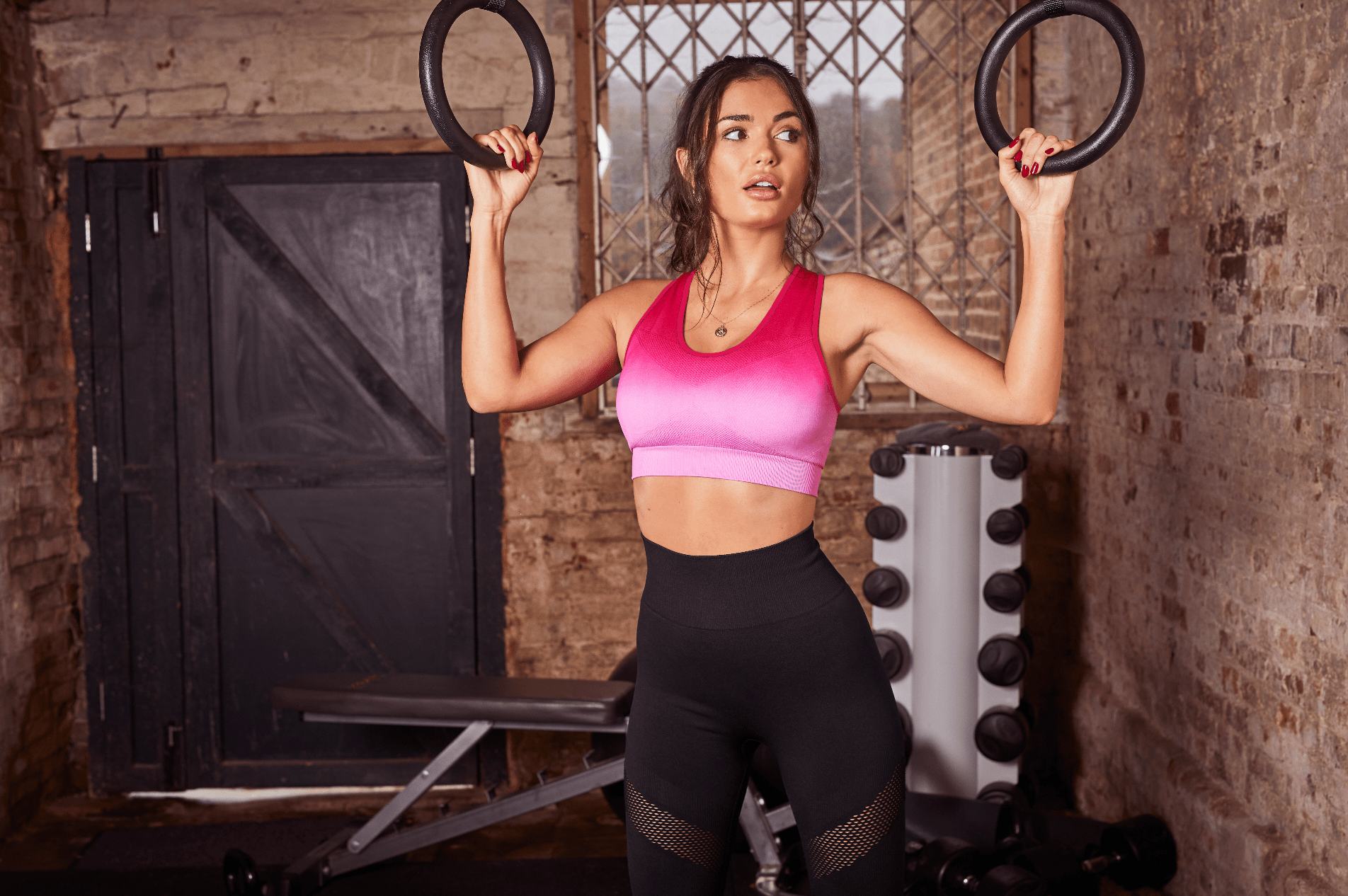 fit woman holds rings