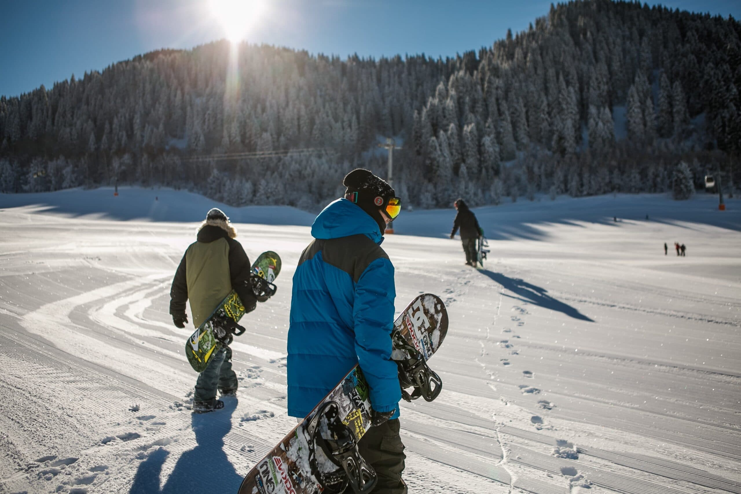 snowboarders prepare to hit the slopes scaled