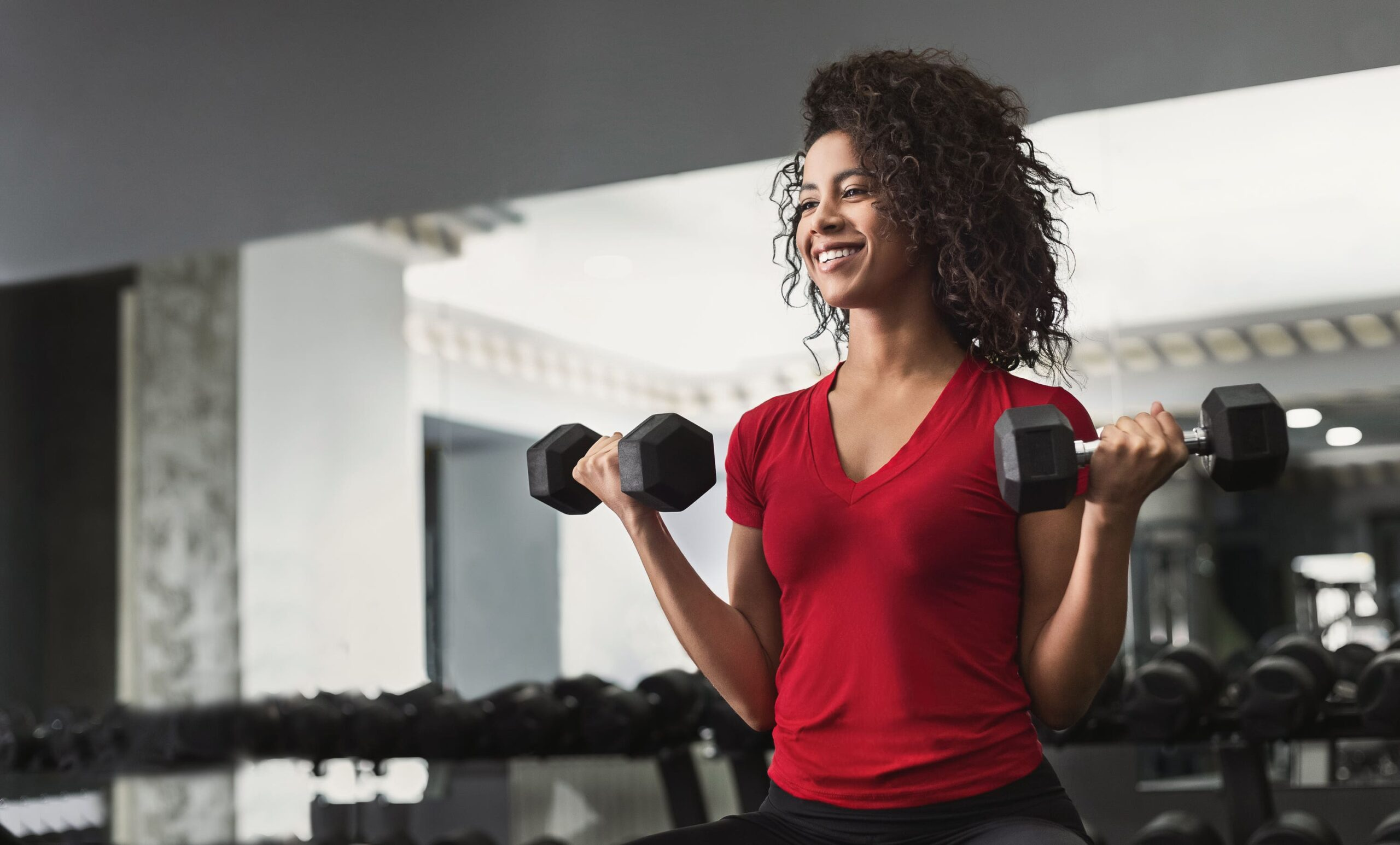 woman working dumbbells scaled