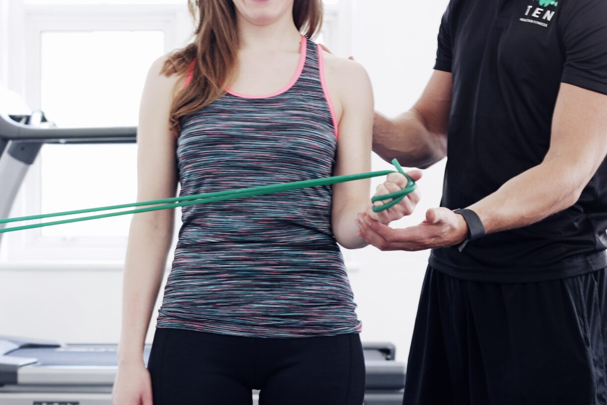 Ten Health PT training with resistance band