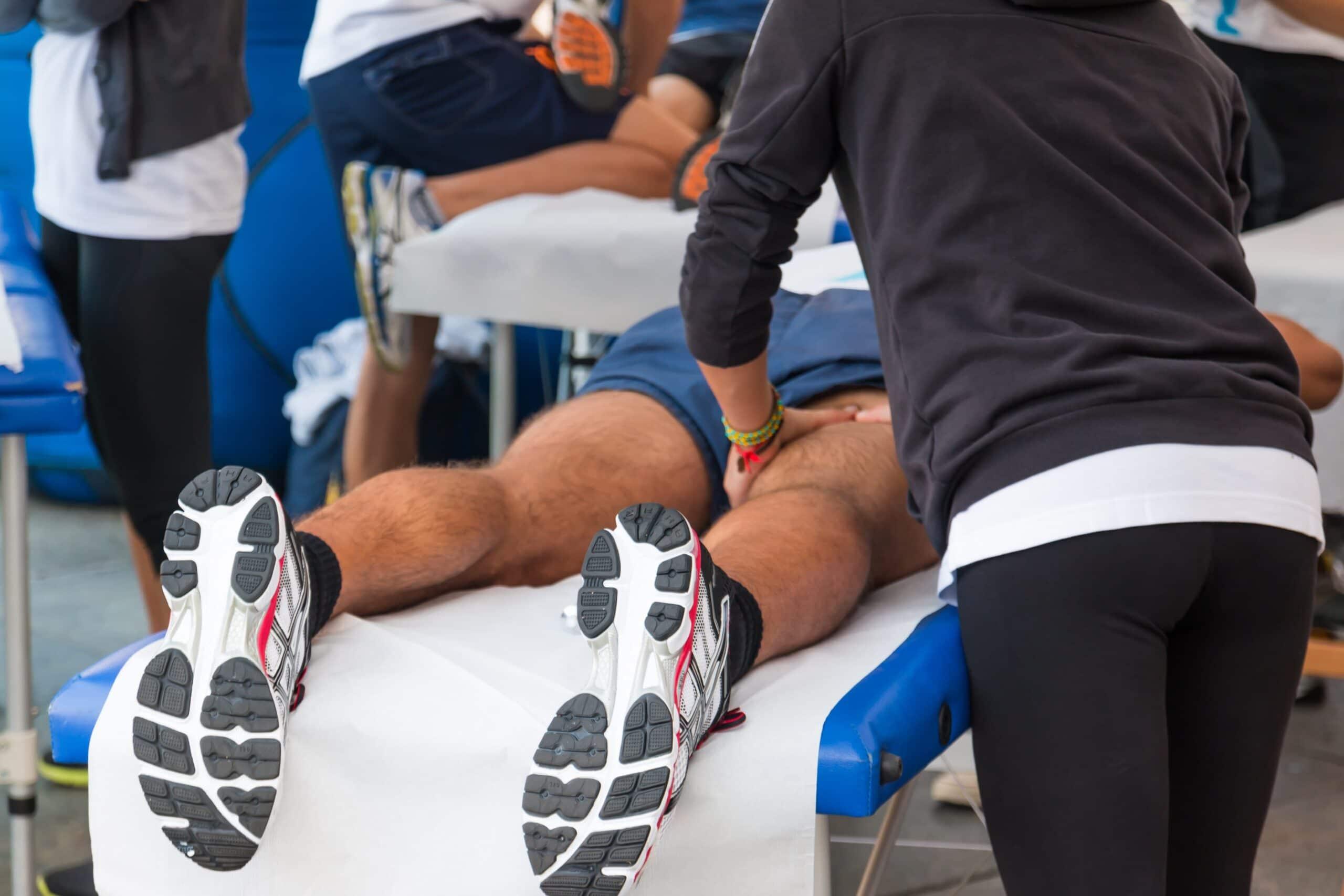 athlete gets leg massage scaled