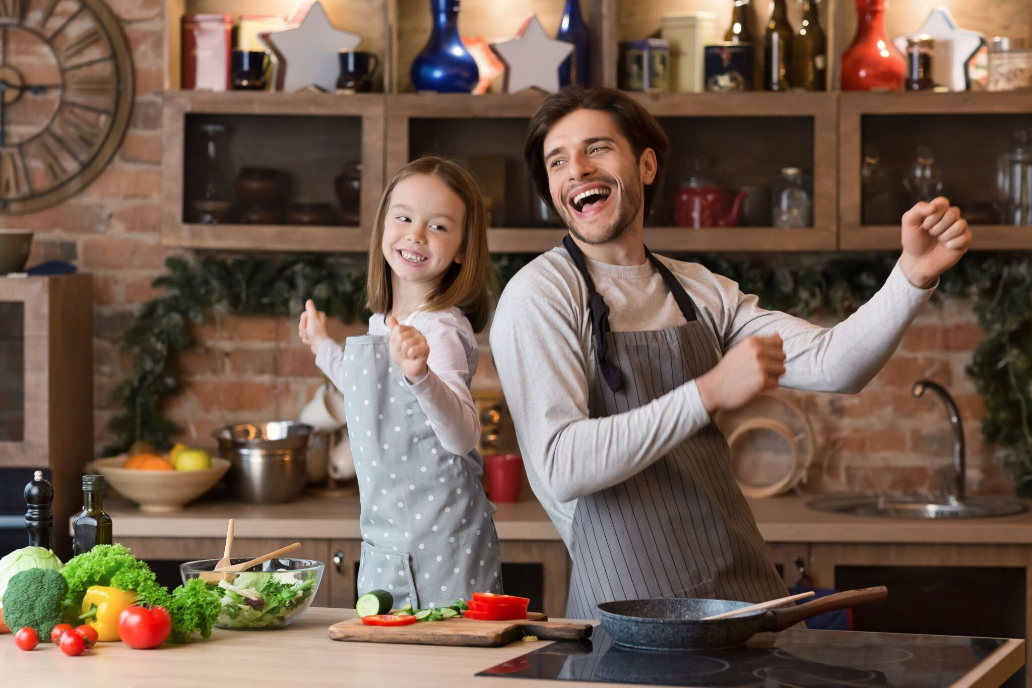 chef and child dance in kitchen