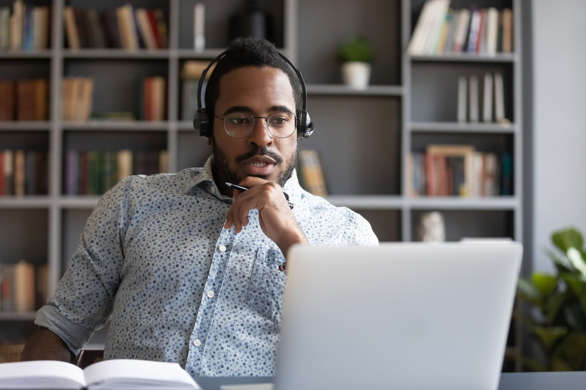 man working with headphones on