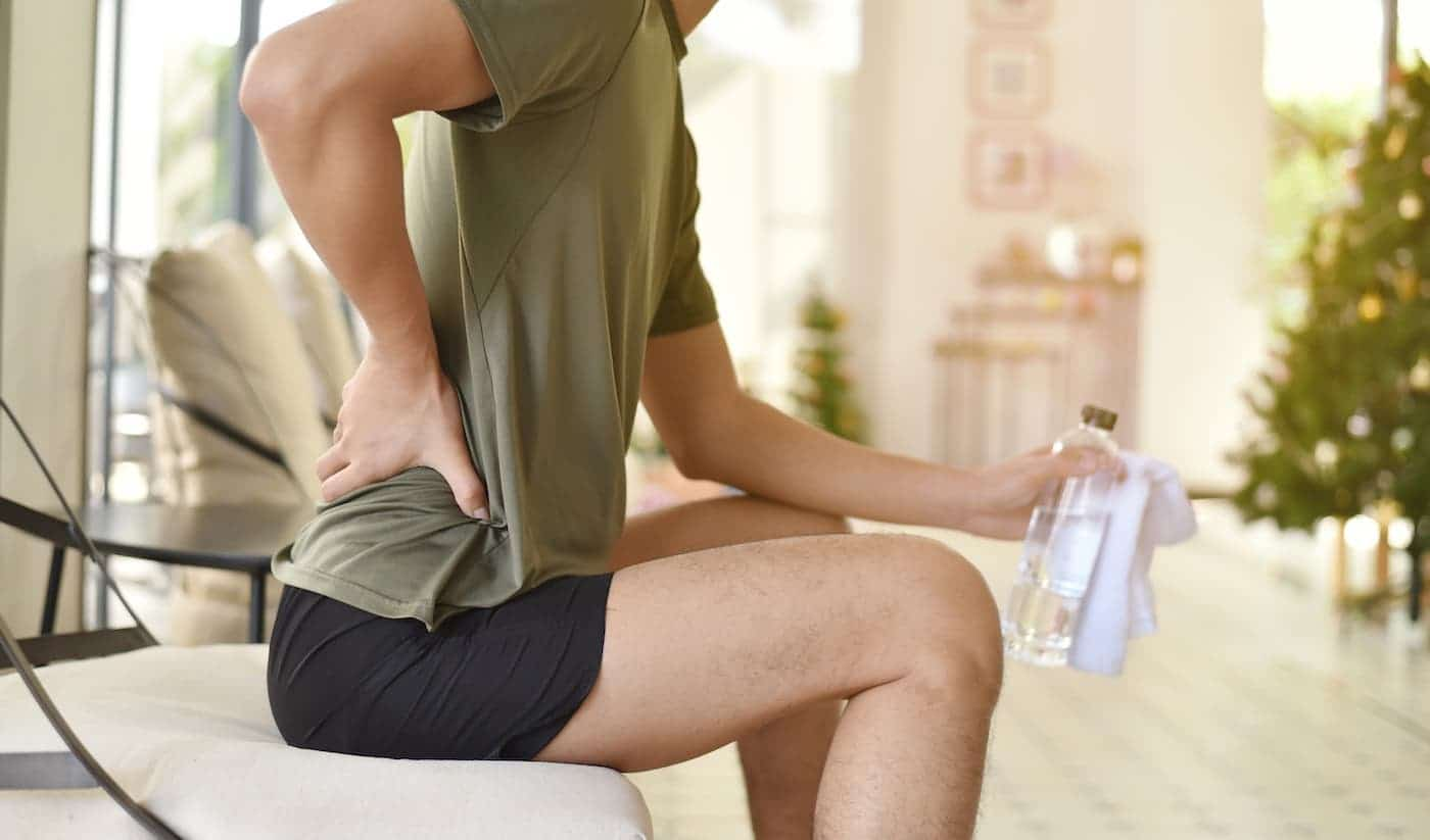 person sitting feels back in pain