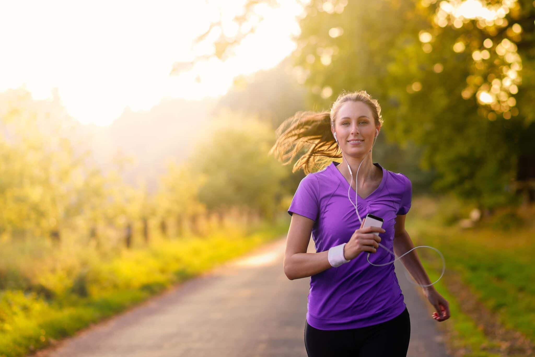 woman runs in sunlight