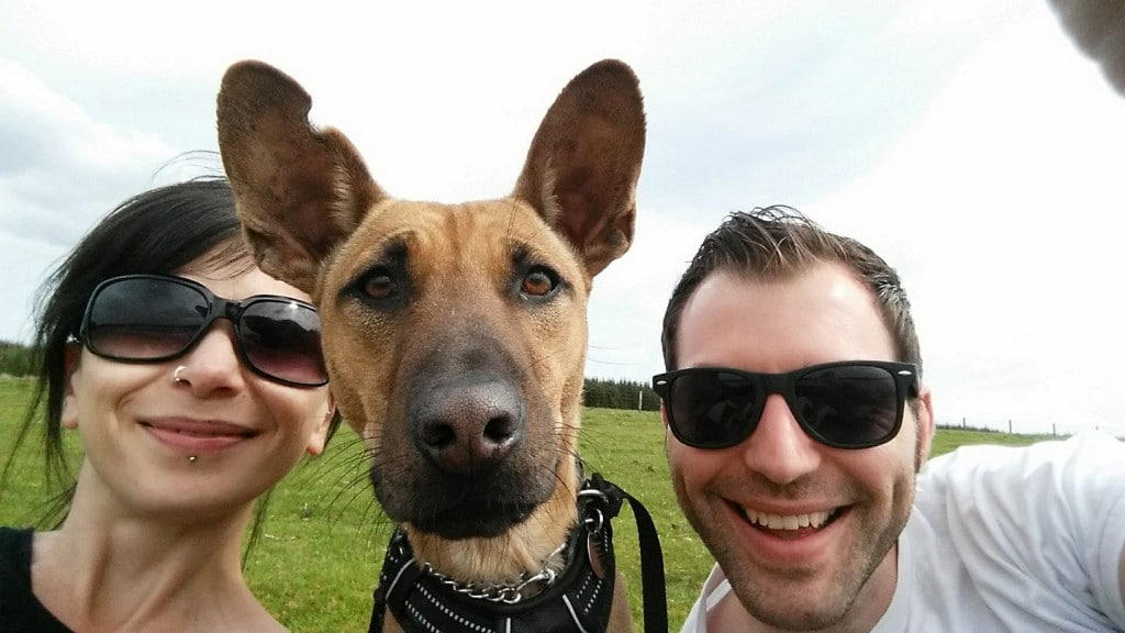 couple take selfie with their dog