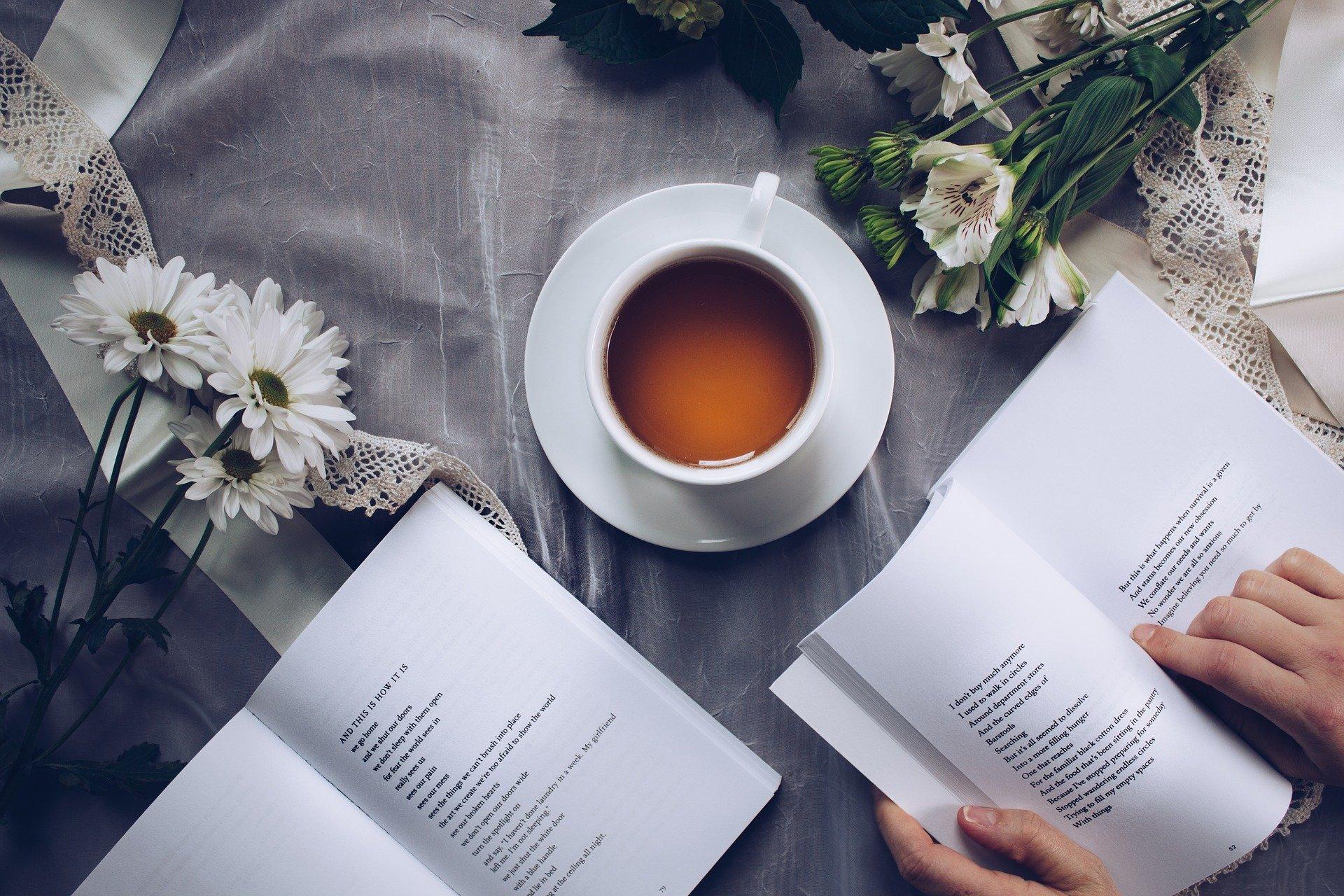 cup of tea amongst books