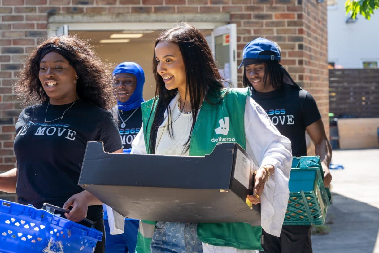 TV star Maya Jama surprises youths in Hackney East London to volunteer as part of Deliveroos Full Life campaign delivering 1m meals to people in the local communities 2