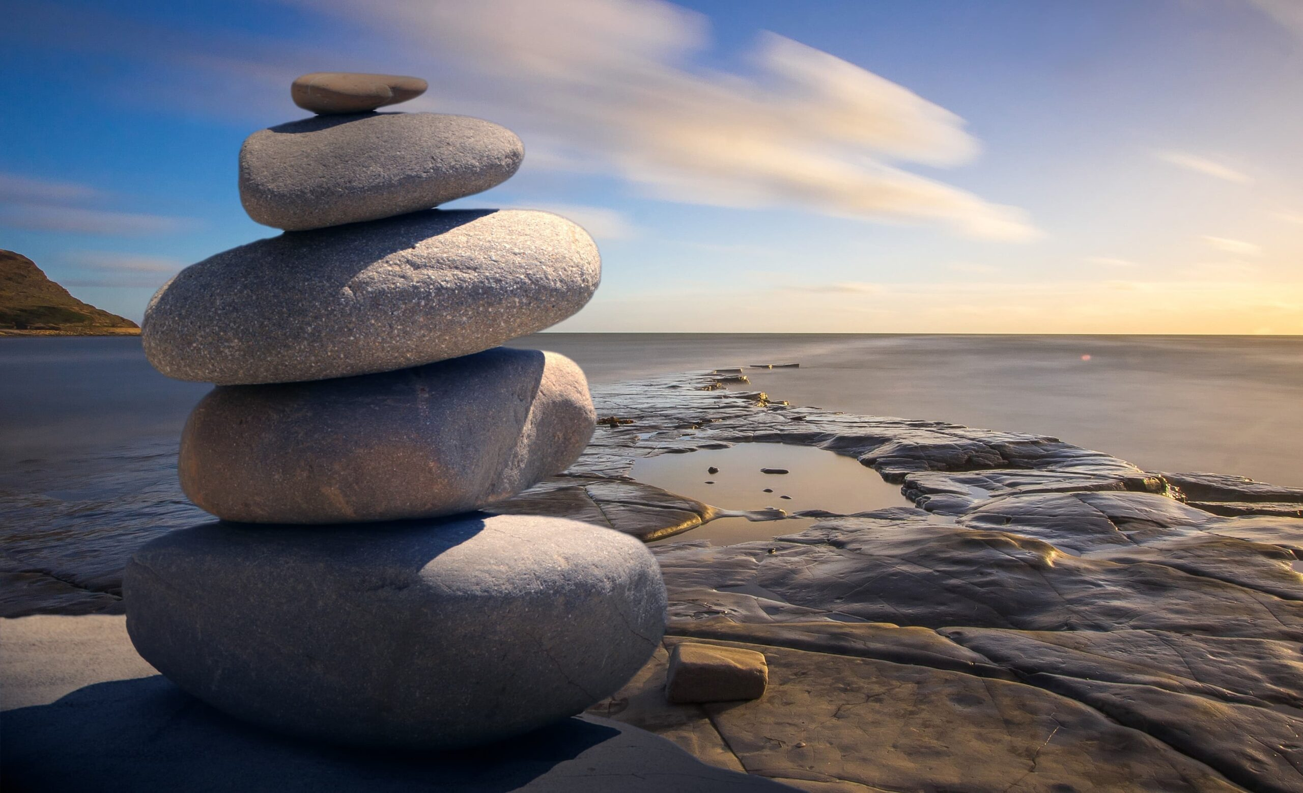 stones stacked on a beach scaled