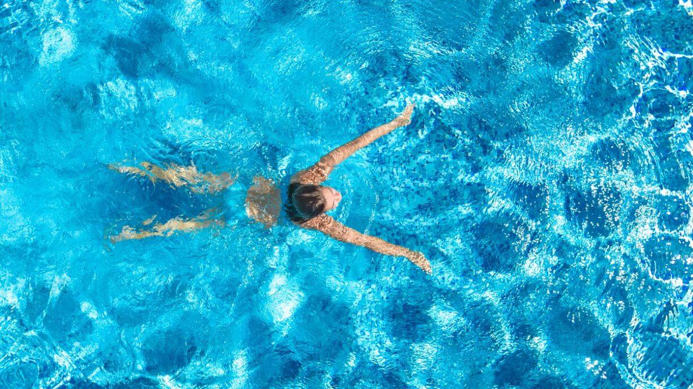 woman swims in pool