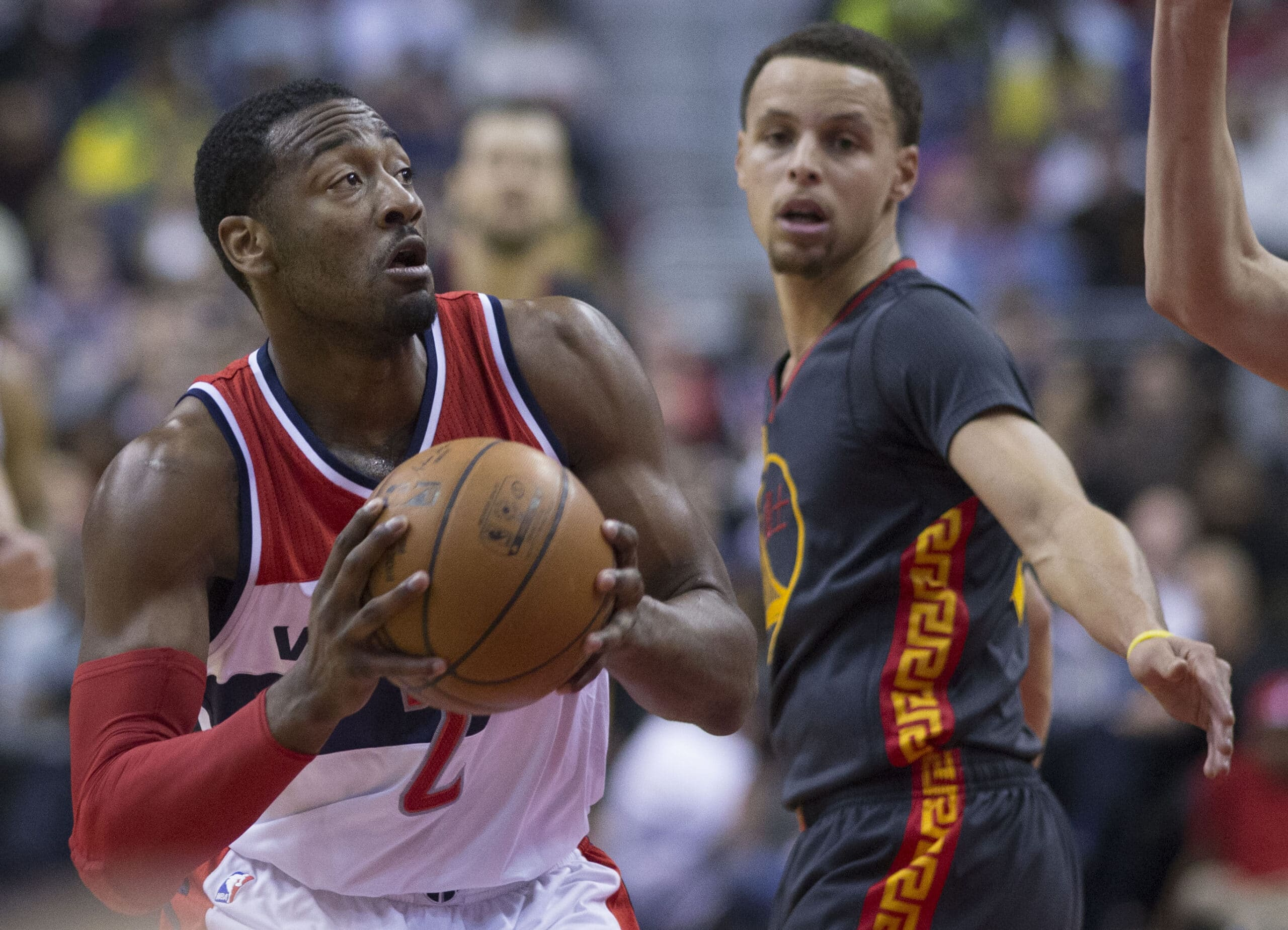 John Wall with Stephen Curry scaled