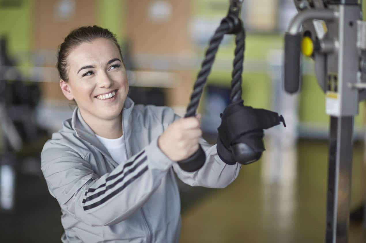 fit woman on pulldown ropes