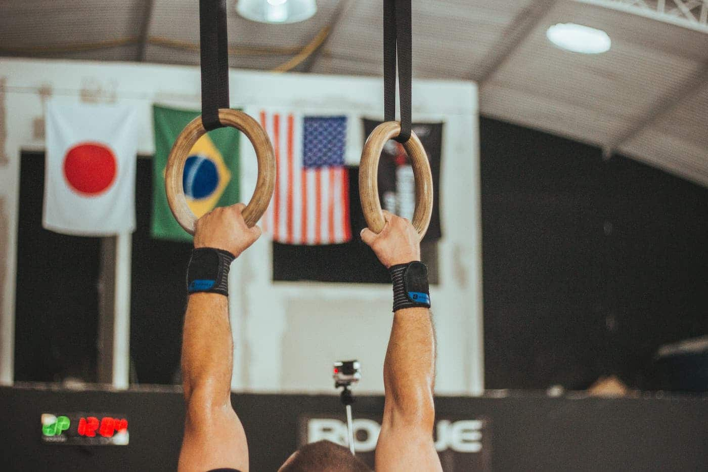 gymnast holds onto rings
