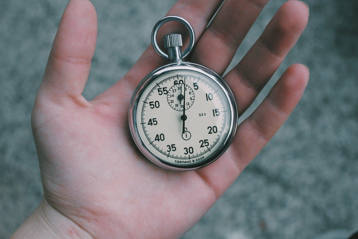 hand holding stop watch