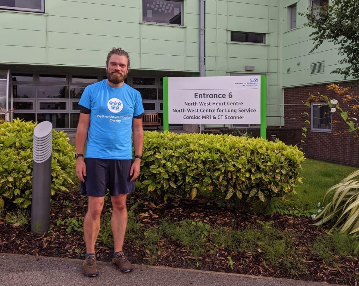Alan wearing his Charity t shirt outside Wythenshawe Hospital