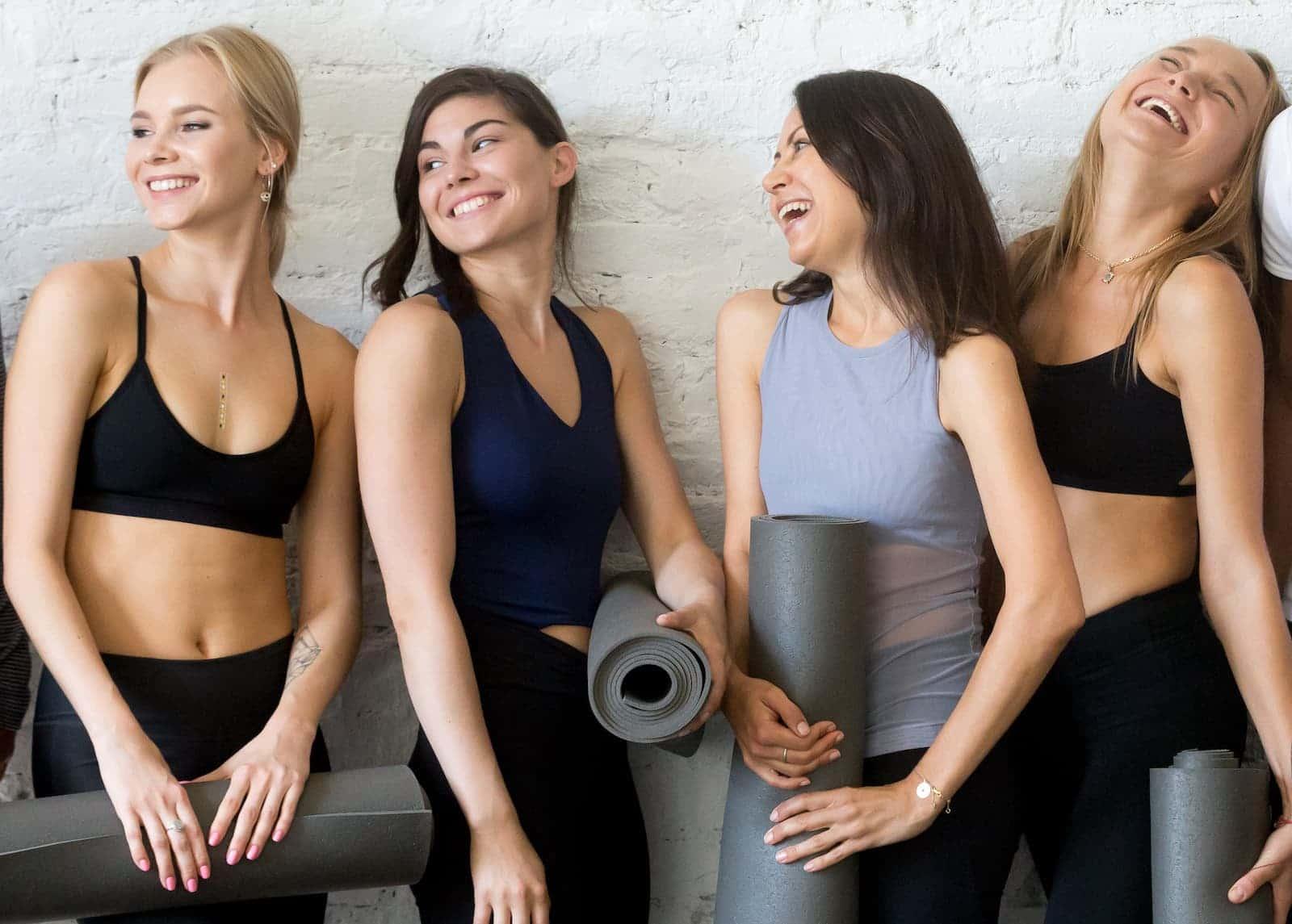group of fitness women in yoga wear