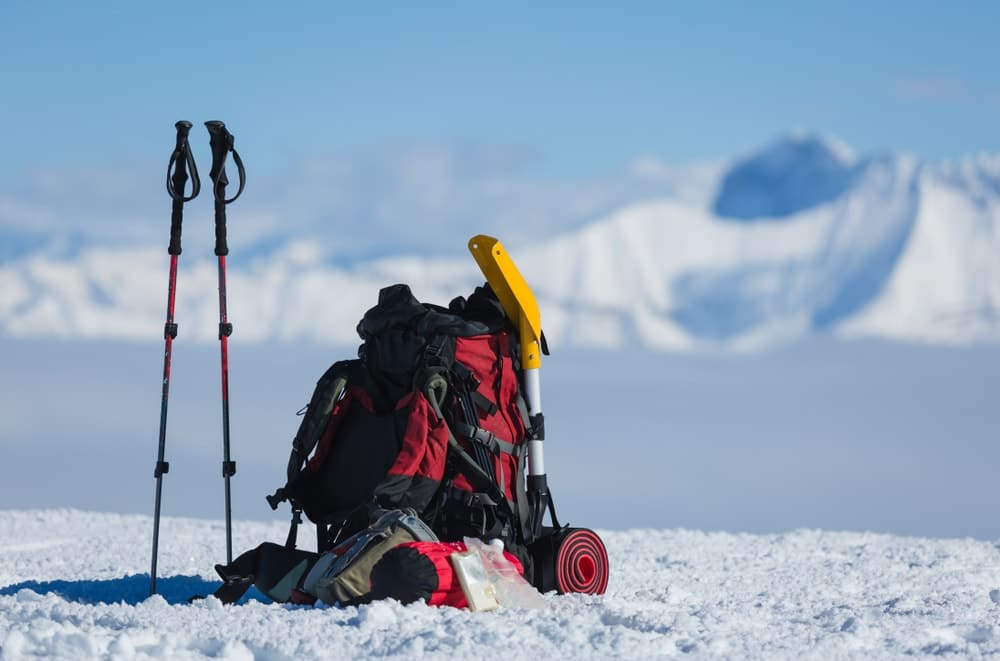 hikers winter gear sits in the snow covered mountains